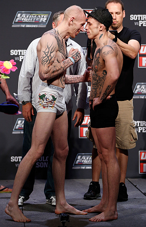 GOLD COAST, AUSTRALIA - DECEMBER 14:  (L-R) Opponents Colin Fletcher and Norman Parke face off during the UFC on FX weigh in on December 14, 2012 at Gold Coast Convention and Exhibition Centre in Gold Coast, Queensland, Australia.  (Photo by Josh Hedges/Z