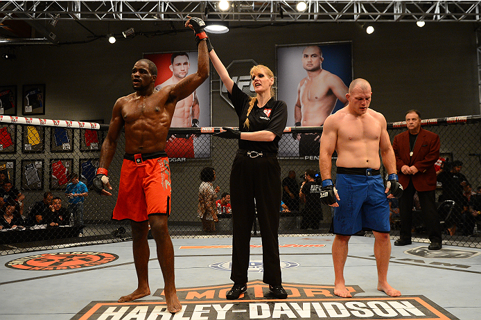 LAS VEGAS, NV - OCTOBER 16:  (L-R) Corey Anderson celebrates after defeating Kelly Anundson in their elimination fight during filming of season nineteen of The Ultimate Fighter on October 16, 2013 in Las Vegas, Nevada. (Photo by Al Powers/Zuffa LLC/Zuffa