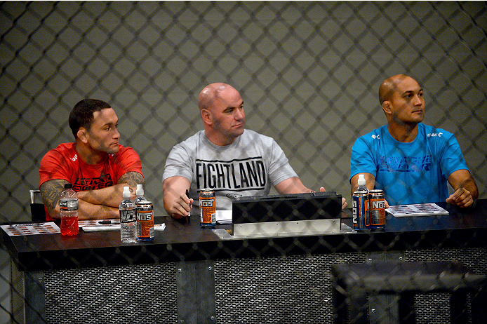 LAS VEGAS, NV - OCTOBER 16:  (L-R) Coach Frankie Edgar, UFC President Dana White and coach BJ Penn watch Eddie Gordon face Matt Gabel in their elimination fight during filming of season nineteen of The Ultimate Fighter on October 16, 2013 in Las Vegas, Ne