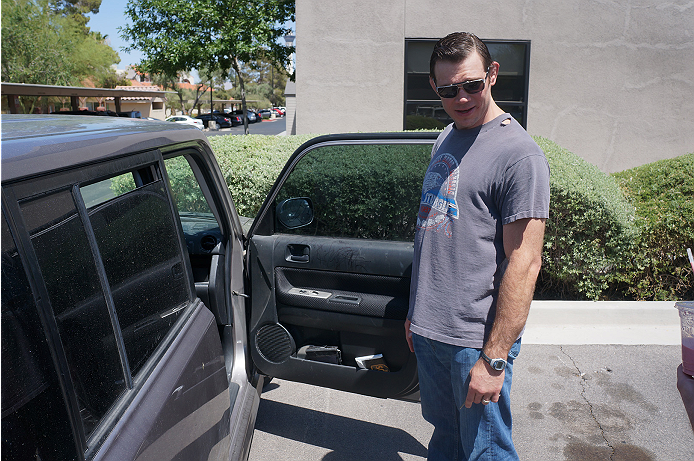 UFC legend Forrest Griffin opens the door of his Scion xB.