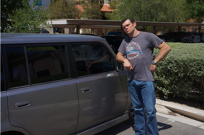 UFC legend Forrest Griffin poses outside of his motor vehicle.
