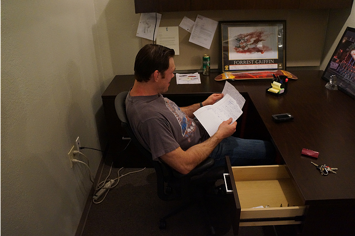 Forrest Griffin laughing at the contents of his notes.