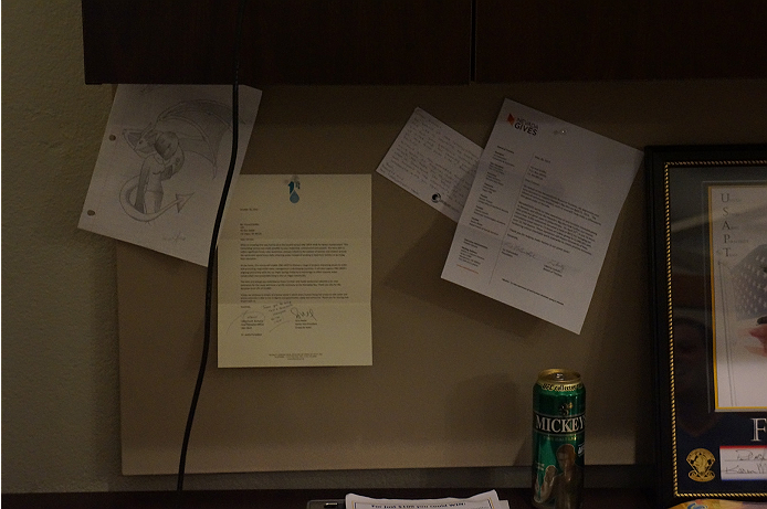 A fans drawing, a thank you letter, and other cool things are pinned to Forrest's wall.