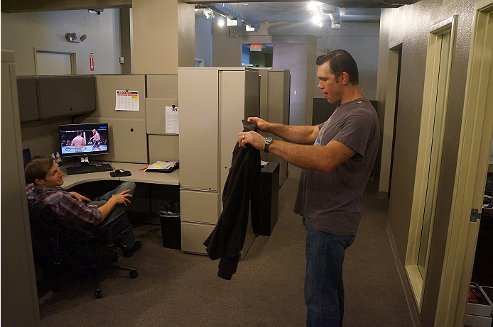 Forrest Griffin mocks a sweater that a colleague wore to work in 100-degree weather.
