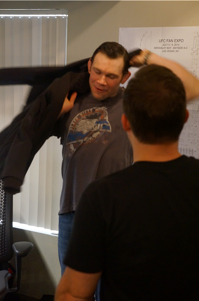 Forrest confronts the UFC employee about his sweater.