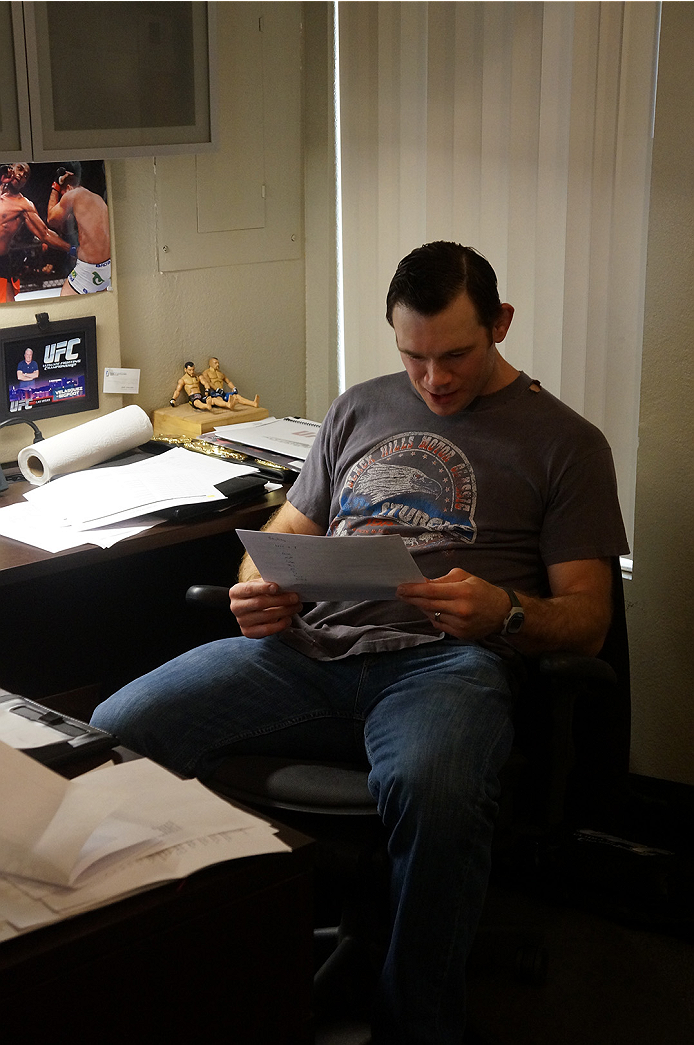 Forrest looking over the betting odds from UFC 174.