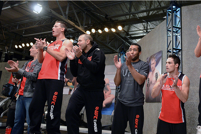 LACHUTE, CANADA - NOVEMBER 5:  Team Canada cheers on fighter Elias Theodorou before his middleweight bout against team Australia fighter Zein Saliba during filming of The Ultimate Fighter Nations television series on November 5, 2013 in Lachute, Quebec, C
