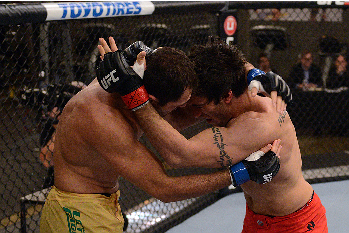 LACHUTE, CANADA - NOVEMBER 5:  (L-R) Team Australia fighter Zein Saliba takes on Team Canada fighter Elias Theodorou in their middleweight bout during filming of The Ultimate Fighter Nations television series on November 5, 2013 in Lachute, Quebec, Canada