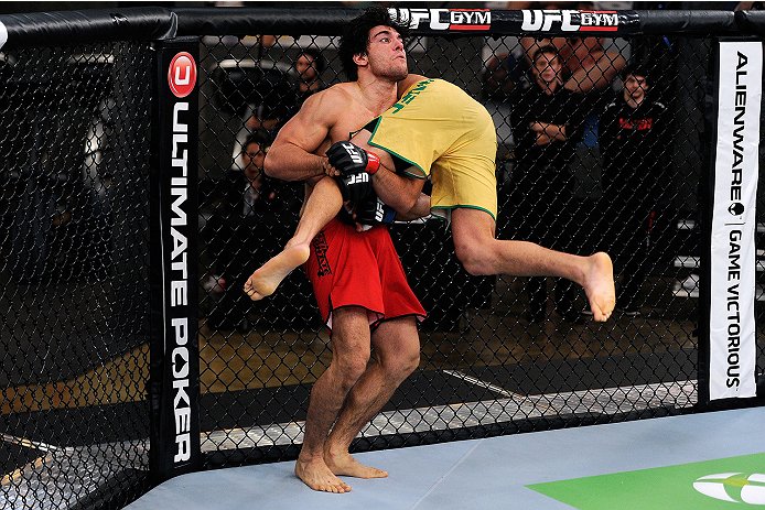 LACHUTE, CANADA - NOVEMBER 5:  (L-R) Team Canada fighter Elias Theodorou attempts a takedown against Team Australia fighter Zein Saliba in their middleweight bout during filming of The Ultimate Fighter Nations television series on November 5, 2013 in Lach