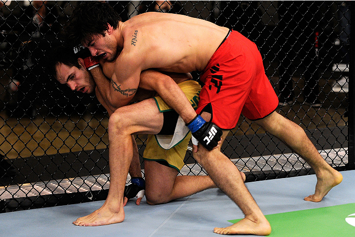 LACHUTE, CANADA - NOVEMBER 5:  Team Canada fighter Elias Theodorou (red shorts) attempts a takedown against Team Australia fighter Zein Saliba in their middleweight bout during filming of The Ultimate Fighter Nations television series on November 5, 2013