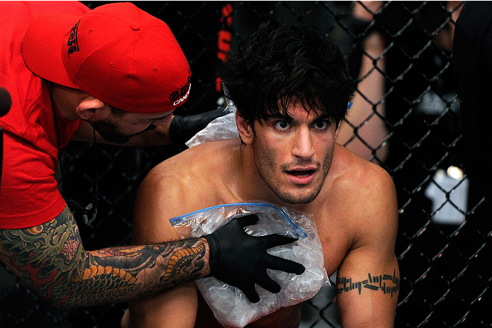 LACHUTE, CANADA - NOVEMBER 5:  Team Canada fighter Elias Theodorou rests in between round during his middleweight bout against Team Australia fighter Zein Saliba during filming of The Ultimate Fighter Nations television series on November 5, 2013 in Lachu