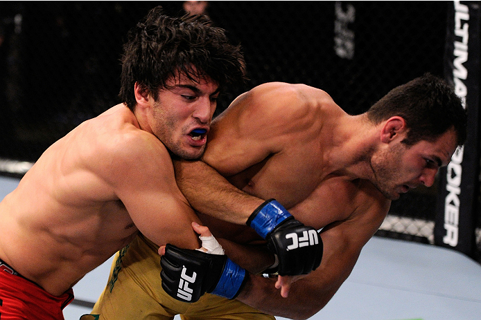 LACHUTE, CANADA - NOVEMBER 5:  (L-R) Team Canada fighter Elias Theodorou takes down Team Australia fighter Zein Saliba in their middleweight bout during filming of The Ultimate Fighter Nations television series on November 5, 2013 in Lachute, Quebec, Cana