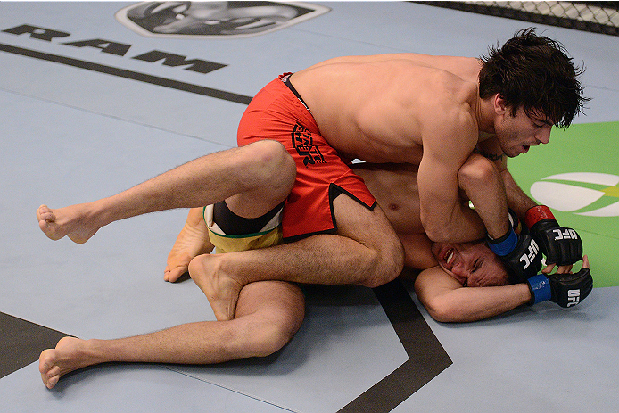 LACHUTE, CANADA - NOVEMBER 5:  (L-R) Team Canada fighter Elias Theodorou controls the body of Team Australia fighter Zein Saliba in their middleweight bout during filming of The Ultimate Fighter Nations television series on November 5, 2013 in Lachute, Qu