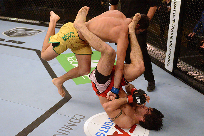 LACHUTE, CANADA - NOVEMBER 5:  (L-R) Team Australia fighter Zein Saliba throws a flying punch at Team Canada fighter Elias Theodorou in their middleweight bout during filming of The Ultimate Fighter Nations television series on November 5, 2013 in Lachute