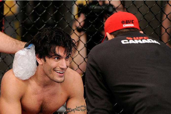 LACHUTE, CANADA - NOVEMBER 5:  Team Canada fighter Elias Theodorou smiles in between rounds during his middleweight bout against Team Australia fighter Zein Saliba during filming of The Ultimate Fighter Nations television series on November 5, 2013 in Lac
