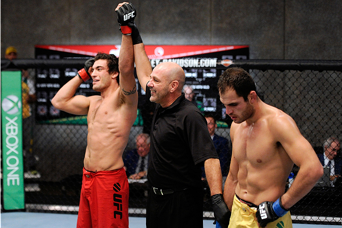 LACHUTE, CANADA - NOVEMBER 5:  (L-R) Team Canada fighter Elias Theodorou is declared the winner  by referee Yves Lavigne after his middleweight bout against Team Australia fighter Zein Saliba during filming of The Ultimate Fighter Nations television serie
