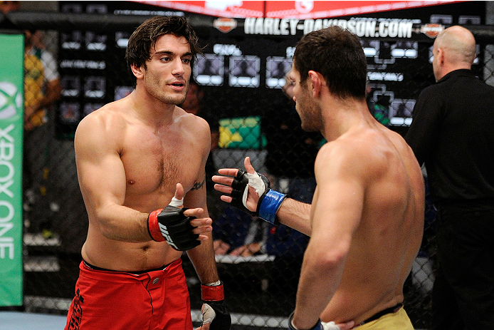 LACHUTE, CANADA - NOVEMBER 5:  (L-R) Team Canada fighter Elias Theodorou is congratulated by Team Australia fighter Zein Saliba after Elias defeated Zein by decision during filming of The Ultimate Fighter Nations television series on November 5, 2013 in L
