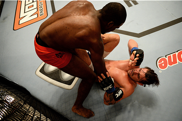 LAS VEGAS, NV - NOVEMBER 5:  (L-R) Team Edgar fighter Corey Anderson punches team Penn fighter Josh Clark in their preliminary fight during filming of season nineteen of The Ultimate Fighter on November 5, 2013 in Las Vegas, Nevada. (Photo by Al Powers/Zu
