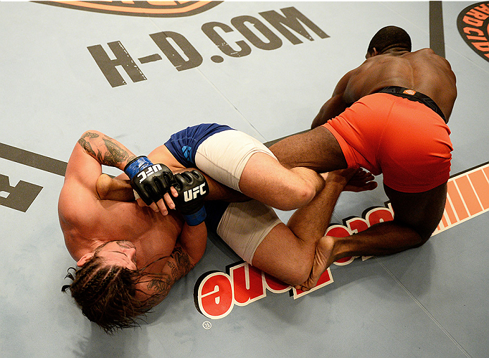 LAS VEGAS, NV - NOVEMBER 5:  (L-R) Team Penn fighter Josh Clark attempts a leg lock on team Edgar fighter Corey Anderson in their preliminary fight during filming of season nineteen of The Ultimate Fighter on November 5, 2013 in Las Vegas, Nevada. (Photo