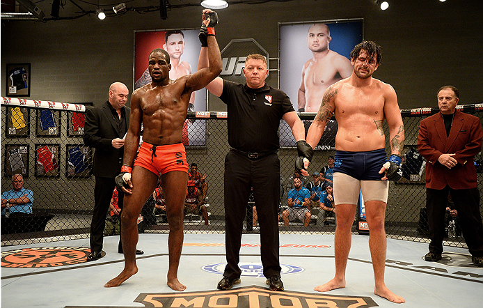 LAS VEGAS, NV - NOVEMBER 5:  (L-R) Team Edgar fighter Corey Anderson celebrates after defeating team Penn fighter Josh Clark in their preliminary fight during filming of season nineteen of The Ultimate Fighter on November 5, 2013 in Las Vegas, Nevada. (Ph