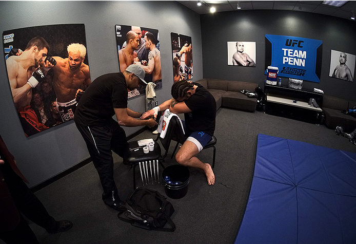 LAS VEGAS, NV - NOVEMBER 5:  Team Penn fighter Josh Clark gets his hands wrapped in the locker room before facing team Edgar fighter Corey Anderson in their preliminary fight during filming of season nineteen of The Ultimate Fighter on November 5, 2013 in
