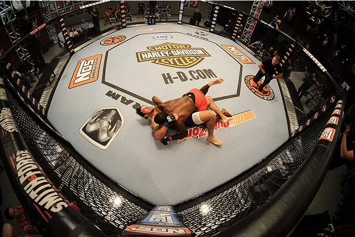 LAS VEGAS, NV - NOVEMBER 5:  (R-L) Team Edgar fighter Corey Anderson takes down team Penn fighter Josh clark in their preliminary fight during filming of season nineteen of The Ultimate Fighter on November 5, 2013 in Las Vegas, Nevada. (Photo by Al Powers