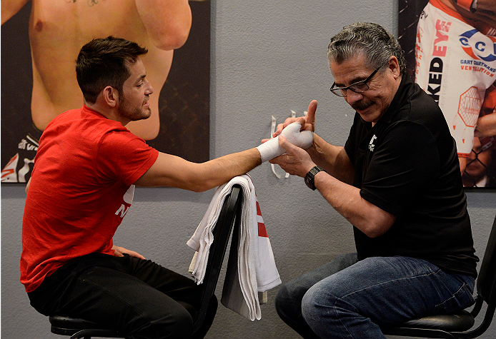 LAS VEGAS, NV - JUNE 3:  Team Velasquez fighter Henry Briones gets his hands wrapped before facing team Werdum fighter Marlon Vera in their preliminary fight during filming of The Ultimate Fighter Latin America on June 3, 2014 in Las Vegas, Nevada. (Photo