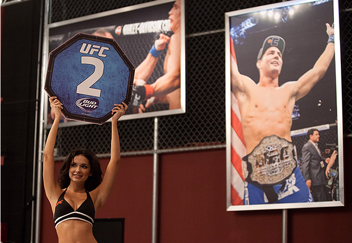 LAS VEGAS, NV - JUNE 10:  UFC Octagon Girl Jamillette Gaxiola signals the first round between Team Velasquez fighter Marco Beltran and team Werdum fighter Guido Cannetti in their preliminary fight during filming of The Ultimate Fighter Latin America on Ju