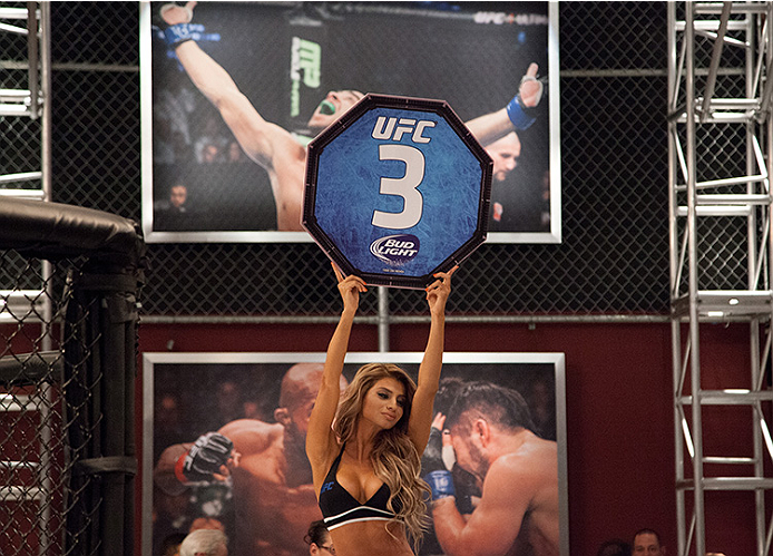 LAS VEGAS, NV - JUNE 10:  UFC Octagon Girl Betzy Montero signals the third round between Team Velasquez fighter Marco Beltran and team Werdum fighter Guido Cannetti in their preliminary fight during filming of The Ultimate Fighter Latin America on June 10