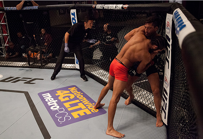 LAS VEGAS, NV - JUNE 10:  (L-R) Team Velasquez fighter Marco Beltran pushes team Werdum fighter Guido Cannetti against the fence in their preliminary fight during filming of The Ultimate Fighter Latin America on June 10, 2014 in Las Vegas, Nevada. (Photo