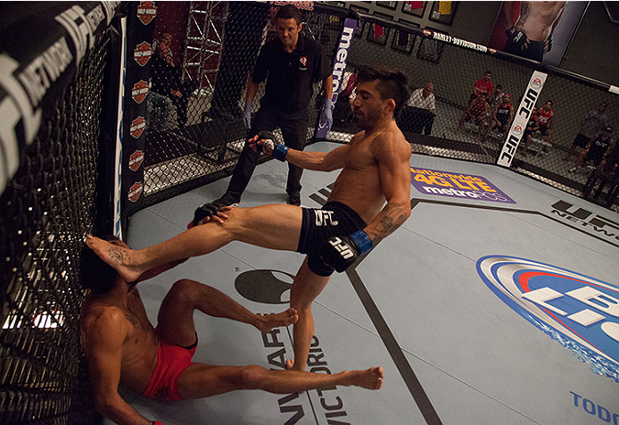 LAS VEGAS, NV - JUNE 10:  Team Werdum fighter Guido Cannetti throws an illegal kick at team Velasquez fighter Marco Beltran in their preliminary fight during filming of The Ultimate Fighter Latin America on June 10, 2014 in Las Vegas, Nevada. (Photo by Br