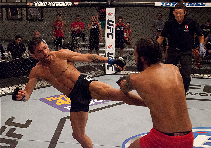 LAS VEGAS, NV - JUNE 10:  Team Werdum fighter Guido Cannetti kicks team Velasquez fighter Marco Beltran in their preliminary fight during filming of The Ultimate Fighter Latin America on June 10, 2014 in Las Vegas, Nevada. (Photo by Brandon Magnus/Zuffa L