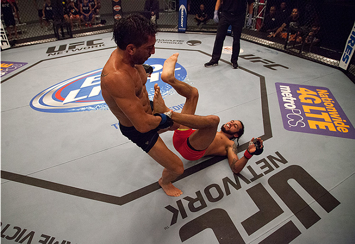 LAS VEGAS, NV - JUNE 10:  Team Werdum fighter Guido Cannetti controls the body of team Velasquez fighter Marco Beltran in their preliminary fight during filming of The Ultimate Fighter Latin America on June 10, 2014 in Las Vegas, Nevada. (Photo by Brandon