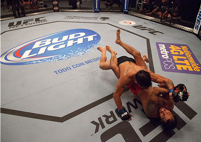 LAS VEGAS, NV - JUNE 10:  Team Werdum fighter Guido Cannetti punches team Velasquez fighter Marco Beltran in their preliminary fight during filming of The Ultimate Fighter Latin America on June 10, 2014 in Las Vegas, Nevada. (Photo by Brandon Magnus/Zuffa