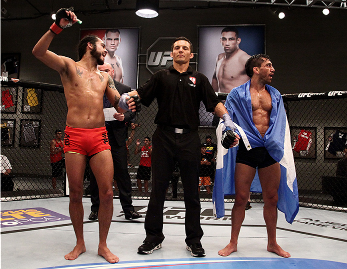 LAS VEGAS, NV - JUNE 10:  Team Velasquez fighter Marco Beltran celebrates his controversial victory over team Werdum fighter Guido Cannetti in their preliminary fight during filming of The Ultimate Fighter Latin America on June 10, 2014 in Las Vegas, Neva