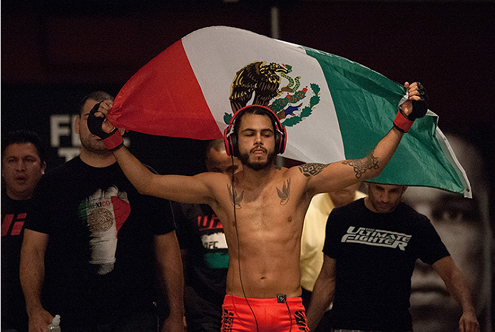 LAS VEGAS, NV - JUNE 10:  Team Velasquez fighter Marco Beltran prepares to enter the Octagon before facing team Werdum fighter Guido Cannetti in their preliminary fight during filming of The Ultimate Fighter Latin America on June 10, 2014 in Las Vegas, Ne