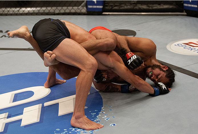 LAS VEGAS, NV - JUNE 10:  Team Velasquez fighter Marco Beltran controls the body of team Werdum fighter Guido Cannetti in their preliminary fight during filming of The Ultimate Fighter Latin America on June 10, 2014 in Las Vegas, Nevada. (Photo by Brandon