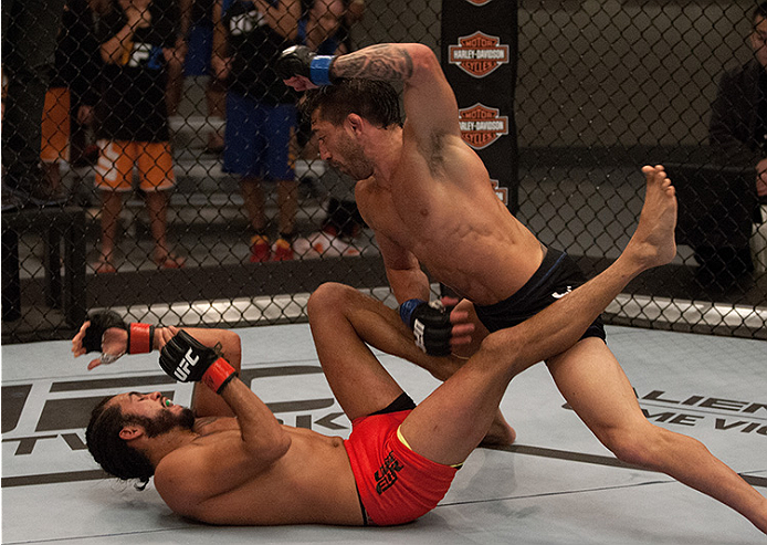 LAS VEGAS, NV - JUNE 10:  (Top) Team Werdum fighter Guido Cannetti punches team Velasquez fighter Marco Beltran in their preliminary fight during filming of The Ultimate Fighter Latin America on June 10, 2014 in Las Vegas, Nevada. (Photo by Brandon Magnus