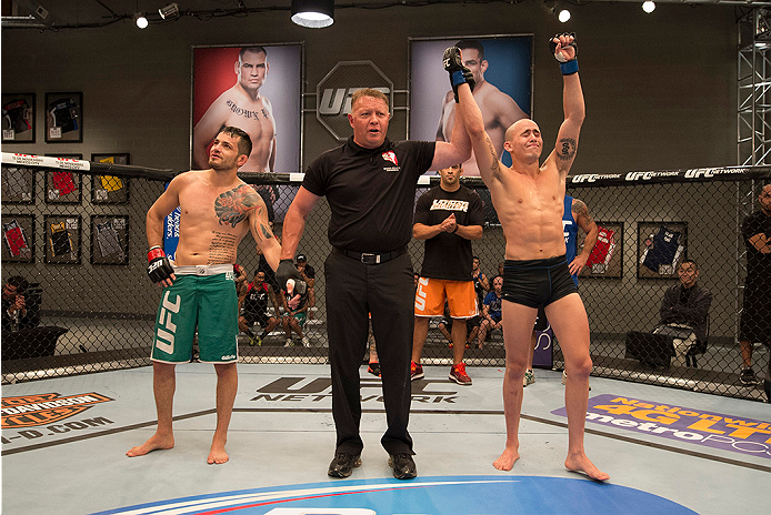 LAS VEGAS, NV - JUNE 3:  (R-L) Team Werdum fighter Marlon Vera celebrates his win over team Velasquez fighter Henry Briones in their preliminary fight during filming of The Ultimate Fighter Latin America on June 3, 2014 in Las Vegas, Nevada. (Photo by Jef