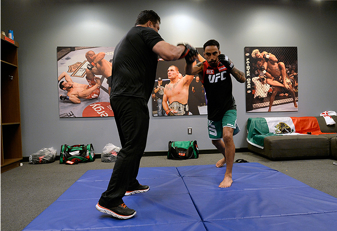 LAS VEGAS, NV - MAY 19:  Team Velasquez fighter Jose Quionez warms up before facing team Werdum fighter Bentley Syler in their preliminary fight during filming of The Ultimate Fighter Latin America on May 19, 2014 in Las Vegas, Nevada. (Photo by Jeff Bott