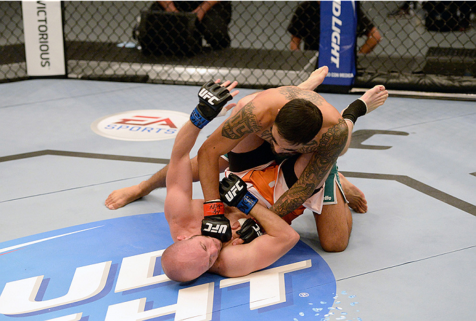 LAS VEGAS, NV - MAY 19:  (R-L) Team Velasquez fighter Jose Quionez punches and controls tho body of team Werdum fighter Bentley Syler in their preliminary fight during filming of The Ultimate Fighter Latin America on May 19, 2014 in Las Vegas, Nevada. (Ph