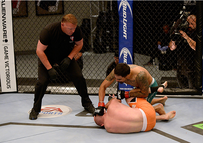 LAS VEGAS, NV - MAY 19:  (R-L) Team Velasquez fighter Jose Quionez punches team Werdum fighter Bentley Syler in their preliminary fight during filming of The Ultimate Fighter Latin America on May 19, 2014 in Las Vegas, Nevada. (Photo by Jeff Bottari/Zuffa