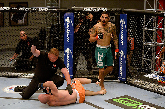 LAS VEGAS, NV - MAY 19:  (R-L) Team Velasquez fighter Jose Quionez celebrates his victory over team Werdum fighter Bentley Syler in their preliminary fight during filming of The Ultimate Fighter Latin America on May 19, 2014 in Las Vegas, Nevada. (Photo b