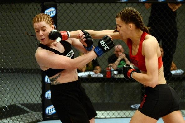LAS VEGAS, NV - MAY 29:  Jessamyn Duke (R) punches Laura Howarth in their elimination fight during filming of season eighteen of The Ultimate Fighter on May 29, 2013 in Las Vegas, Nevada. (Photo by Al Powers/Zuffa LLC/Zuffa LLC via Getty Images)