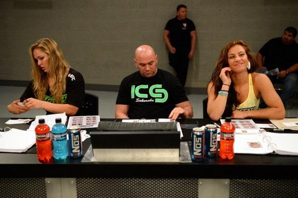 LAS VEGAS, NV - MAY 29:  (L-R) Coach Ronda Rousey, UFC President Dana White and coach Miesha Tate analyze fighters during filming of season eighteen of The Ultimate Fighter on May 29, 2013 in Las Vegas, Nevada. (Photo by Al Powers/Zuffa LLC/Zuffa LLC via