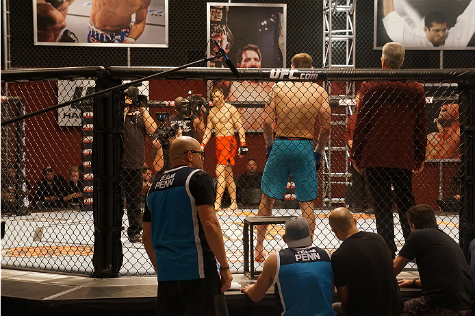 Team Penn's Chris Fields and Team Edgar's Matt Van Buren eyeball each other from across the Octagon in anticipation of their bout.