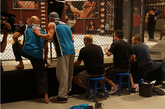 Team Penn coaches watch intently as Chris Fields and Matt Van Buren duke it out in the Octagon.