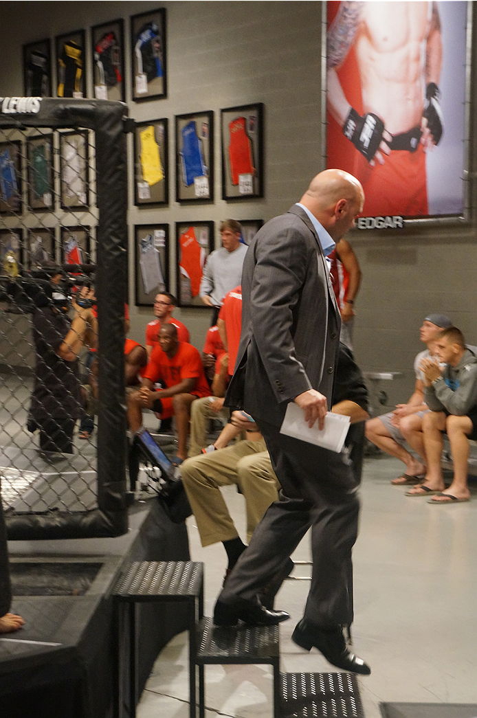 UFC president Dana White leaves the Octagon after announcing the ruling from the judges.