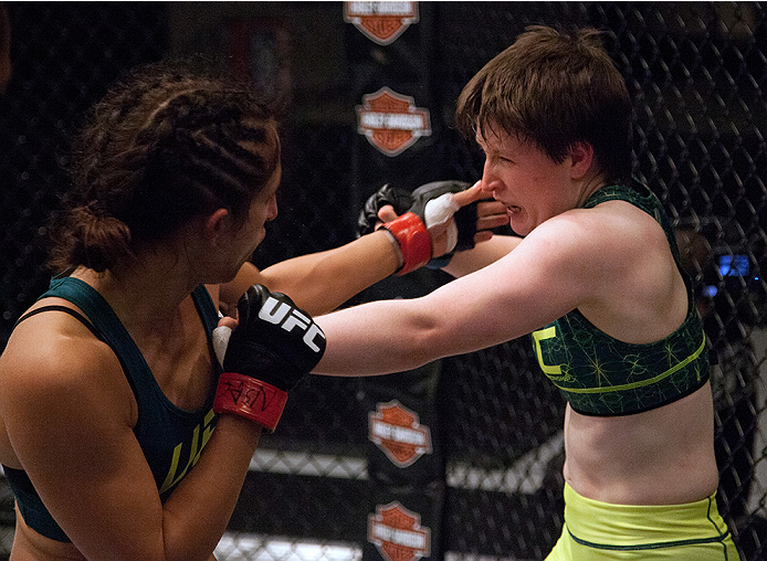 LAS VEGAS, NV - AUGUST 5:  (L-R) Team Pettis fighter Jessica Penne exchanges punches with team Pettis fighter Aisling Daly during filming of season twenty of The Ultimate Fighter on August 5, 2014 in Las Vegas, Nevada. (Photo by Brandon Magnus/Zuffa LLC/Z