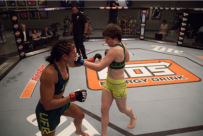 LAS VEGAS, NV - AUGUST 5:  (R-L) Team Pettis fighter Aisling Daly punches team Pettis fighter Jessica Penne during filming of season twenty of The Ultimate Fighter on August 5, 2014 in Las Vegas, Nevada. (Photo by Brandon Magnus/Zuffa LLC/Zuffa LLC via Ge